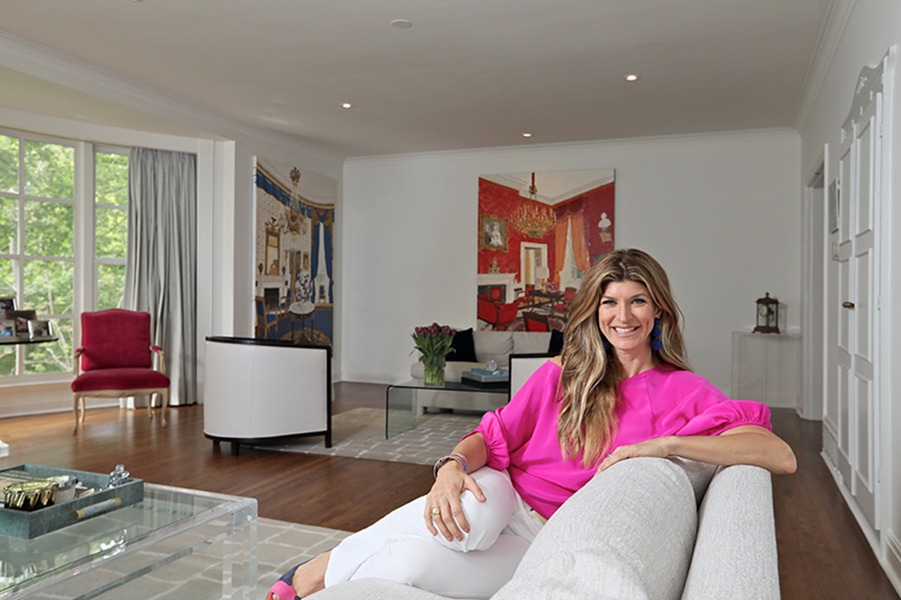 Suzanne Cohon, co-founder of ASC Public Relations, in her (rented) Rosedale home she shares with her husband Mark Cohon,11-year-old daughter and German Shepherd. Behind Cohon is The Red Room and The Blue Room, two of three cherished paintings of rooms at The White House. (Photos by Jordan Prussky)