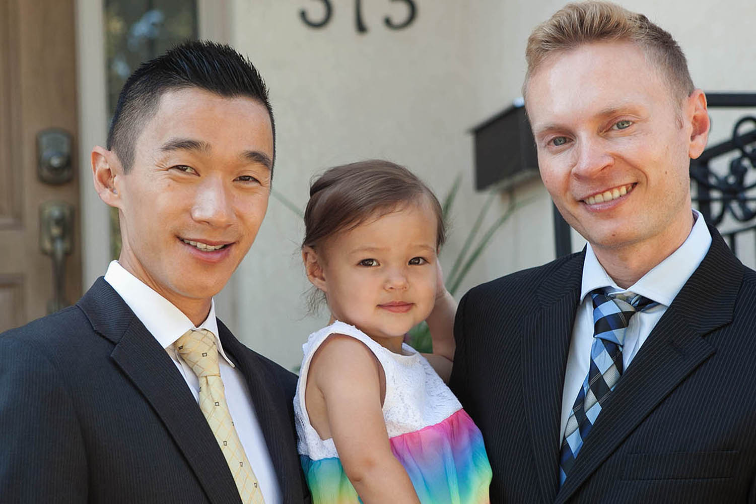 Paul Chan and Ewan French, seen her with their daughter, Jasmine Diane Chan, who turns 3 in June, believe working with family offers valuable support and loyalty.