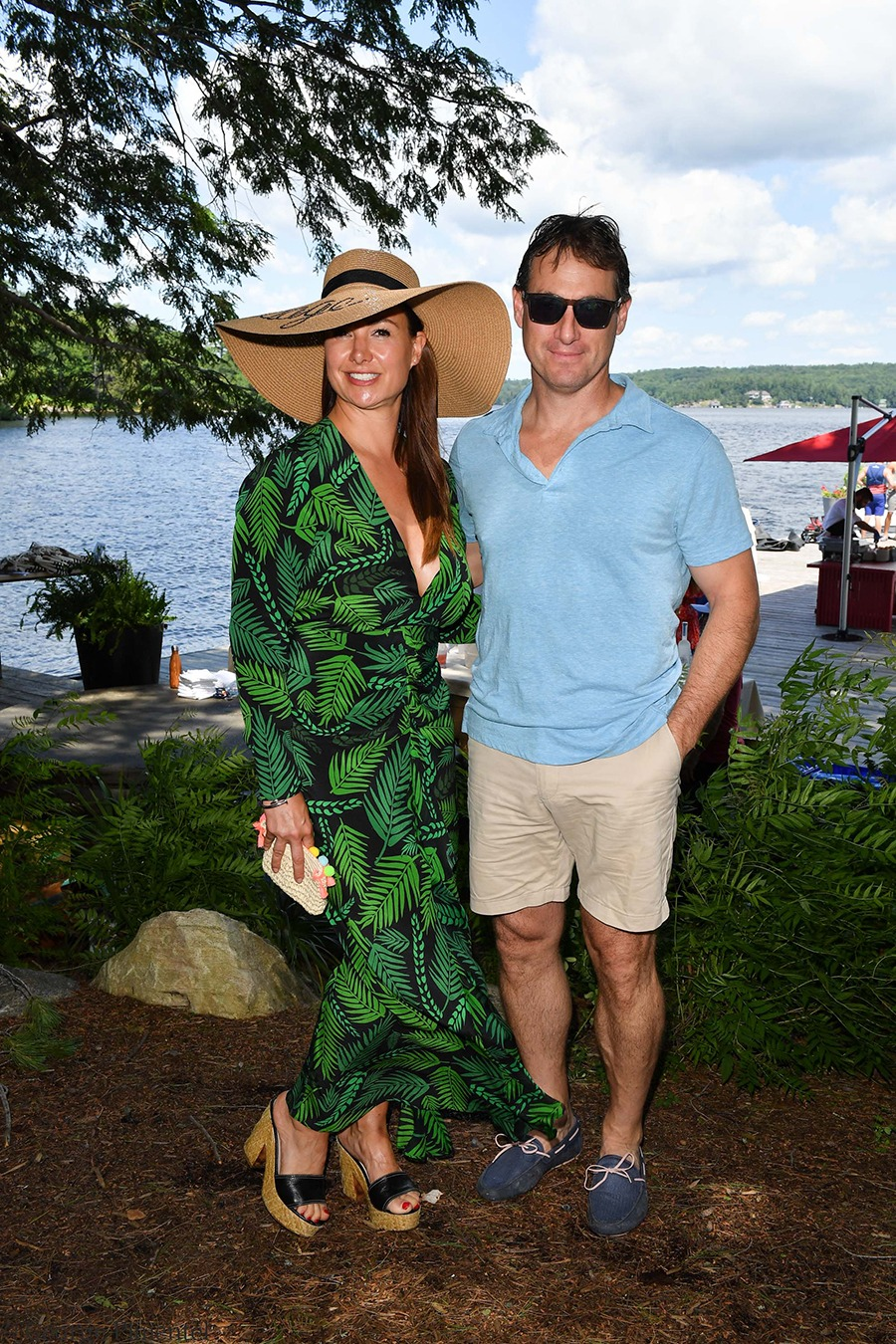 Cottage owners and dock party hosts, Tamara Bahry and Rob White. (Photo by George Pimentel for Commission Yourself)