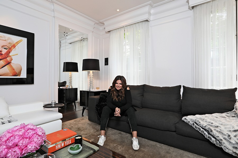 "Public Relations guru Natasha Koifman in the living room of her home she frequently calls, ""her sanctuary"" — and with good reason. The house has a ton of history dating back to 1888. Purchased 7 years ago by Koifman, the house has been renovated and designed incredibly, all room with Koifman's neutral tone theme, with only a few pops of colour."
