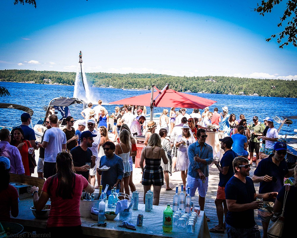 The flyboarders of Muskoka Wake add a fantastical backdrop to the party at the cottage owned bysocialites Tamara Bahry and Rod White.(Photo by George Pimentel for Commission Yourself)