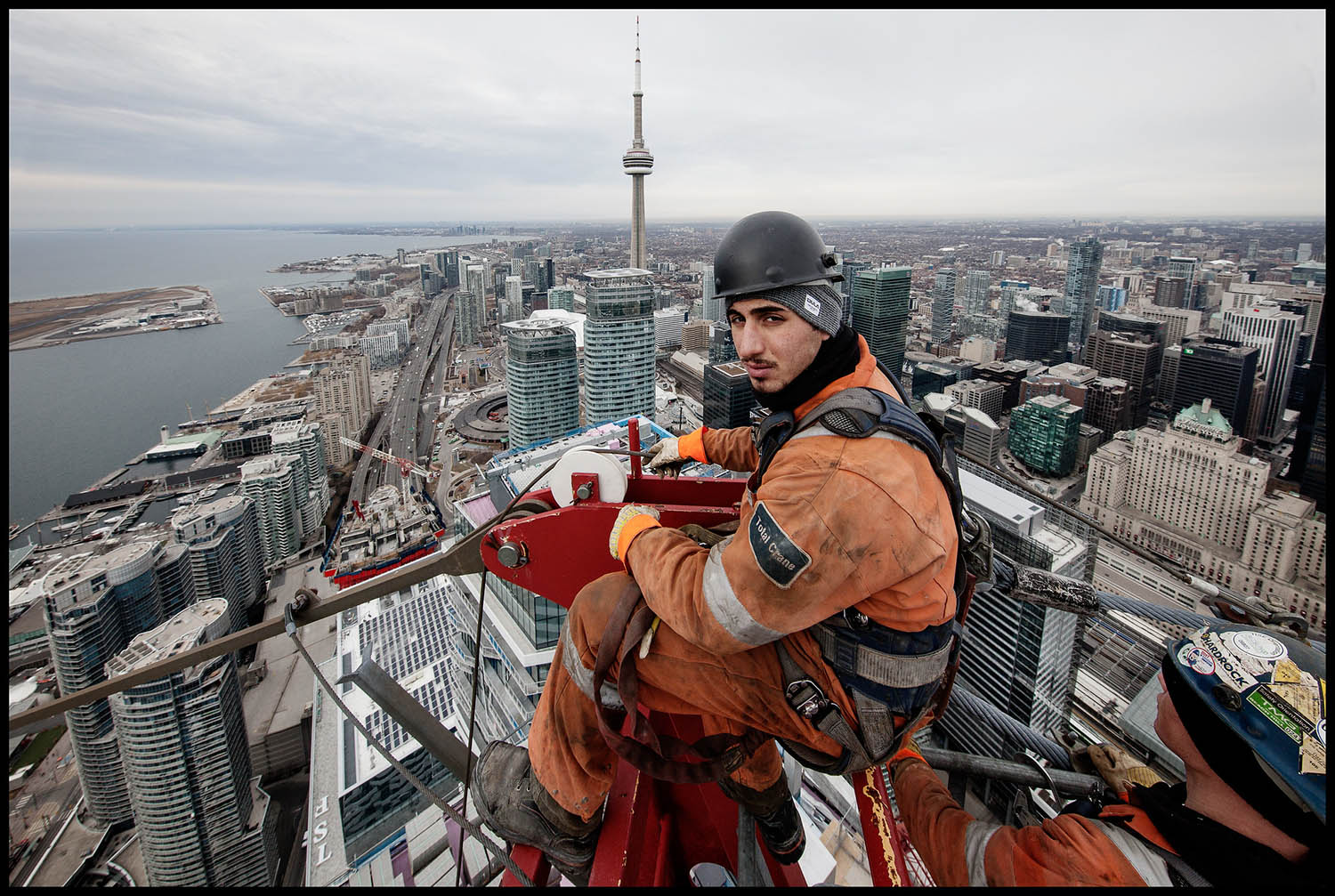 Crane Rigger, Marco Ottorino, sits at the apex of Harbour Plaza's East Tower Crane as it is taken down in February. The photography for this project took place at the Harbour Plaza and the One York Street site over the past four years.